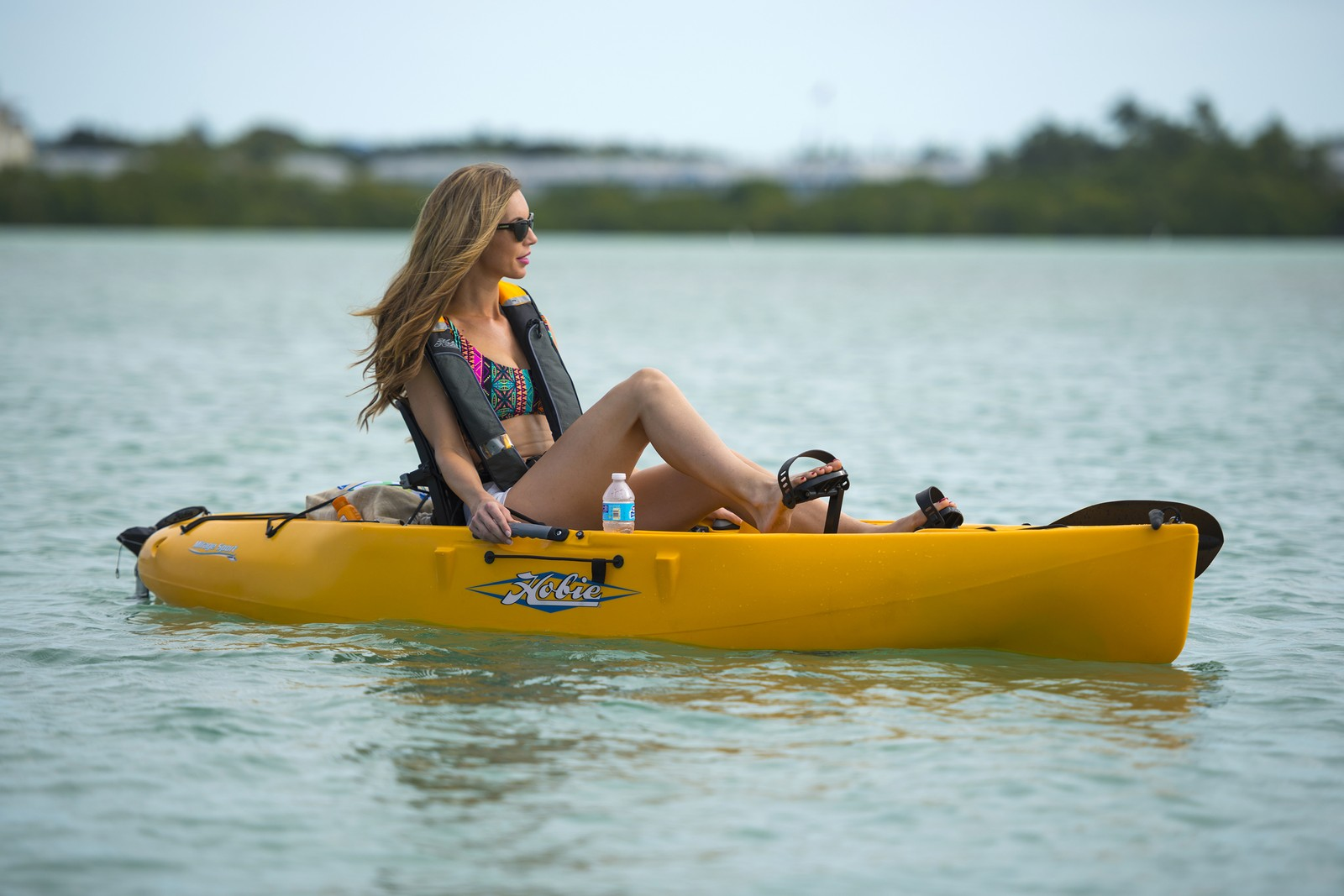 yacht watersports enthusiasts enjoy the hobie mirage single pedal kayak is perfect for exploring near the beach