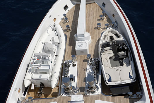 rib and water sports boat stored on deck at bow of a superyacht