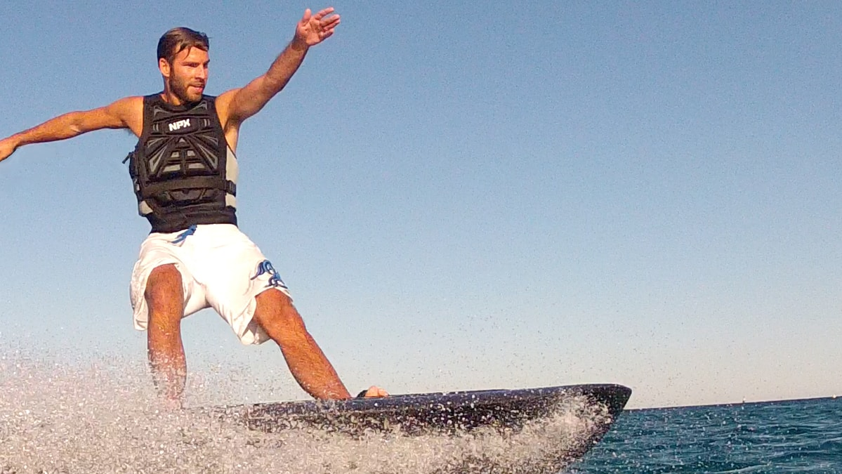 young man enjoys a day on the ocean with her radinn board g2x model